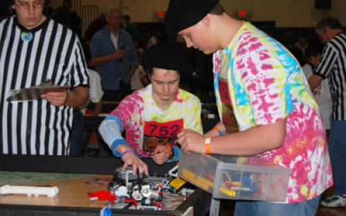 """Members of the Bayport """"Peaced Together"""" — Team #752 prepare to program their robot for the course at the March 6 Long Island LEGO League Tournament, """"Body Forward."""" Five hundred students from 48 teams participated in the event."""